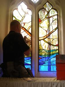 Terry installing the window at All Saints' Church