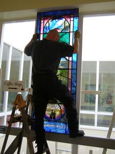 Terry carefully lifting the window into its place